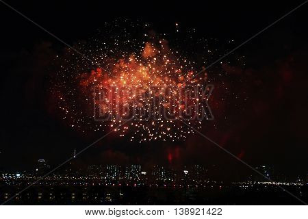 Red fireworks on sky. International Fireworks. Fireworks display on dark sky background.