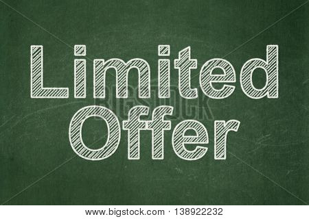 Business concept: text Limited Offer on Green chalkboard background