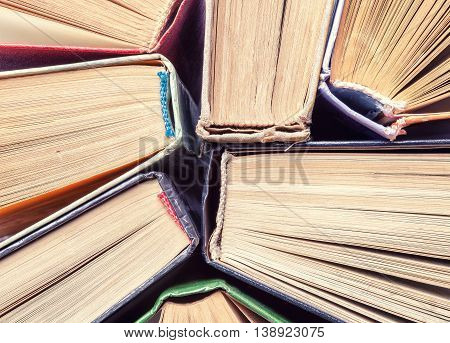 Background of old vintage books closeup. Top view