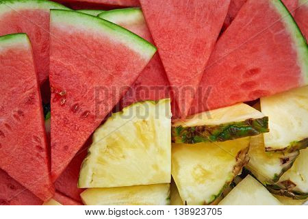 Closeup image of sliced pineapple and watermelon