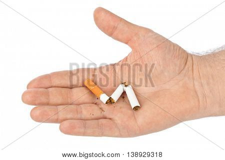 Broken cigarette in hand isolated on white background