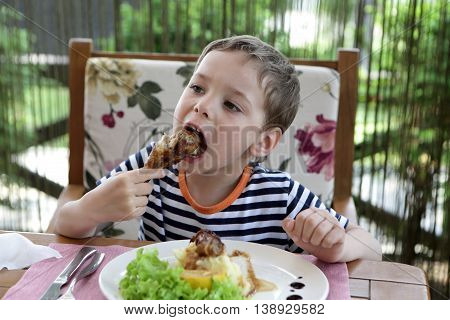Child Eating Chicken Leg