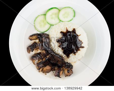 Grilled chicken teriyaki with rice and vegetables on a white plate isolated on the black background with clipping path