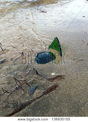 broken bottle at the beach, very dangerous to go swimming