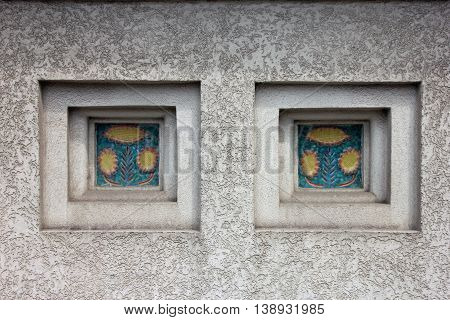 niches with decorative inserts of ceramic tile on white plastered wall