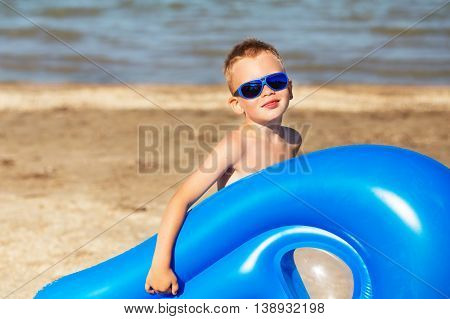 Child Is Going To Swim In The Sea With A Swimming Mattress