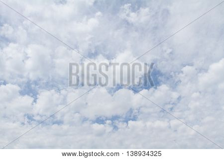white clouds on a blue sky on a sunny day