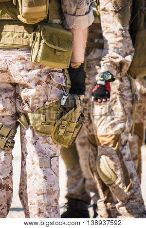 Military man with a gun on his leg