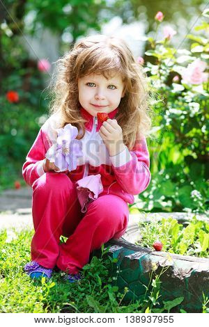 little girl with strawberry on nature home backgraund