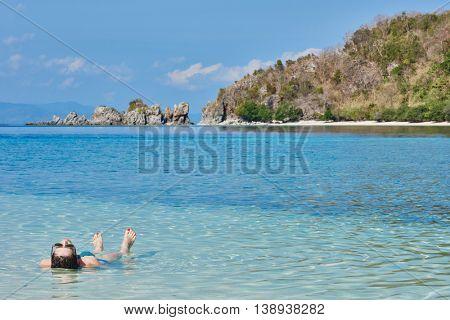 tourist sunbathing swimming Palawan Philippines