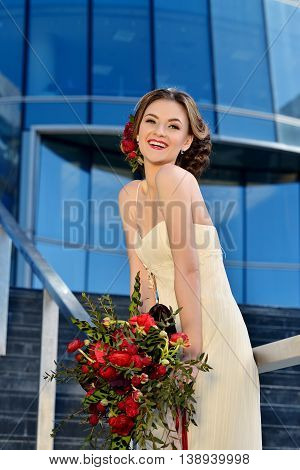 Beauty Bride In Bridal Gown With Bouquet On The Nature. Beautiful Model Girl In A White Wedding Dres
