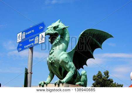 Dragon bridge in a summer day in Ljubljana with turistic signs Slovenia