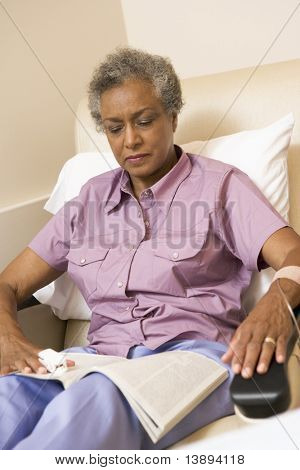 Patient Reading A Magazine, Whilst receiving Chemotherapy