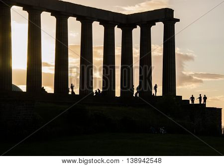 Silhouettes of people on National monument, Calton hill