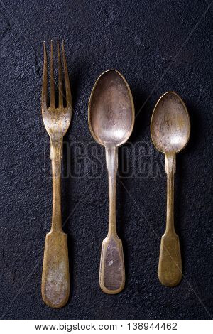 old cutlery on stone table . retro foto