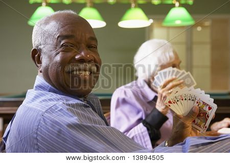 Senior man playing bridge