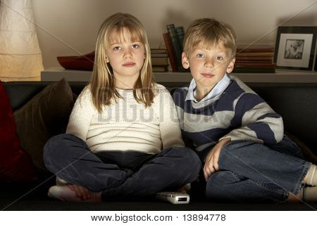 Brother And Sister Watching Television
