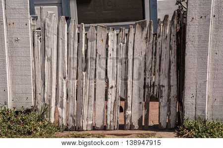 Old Picket Concave Closed  Fence Gate With Peeled White Paint