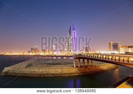 MANAMA, BAHRAIN - MAY 14, 2016: Beautiful view of the Seafront with illuminated World Trade Center and other high rise buildings.