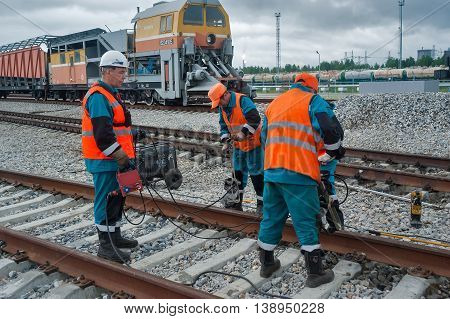 Tobolsk, Russia - July 15. 2016: Sibur company. Railway workers repairing railway