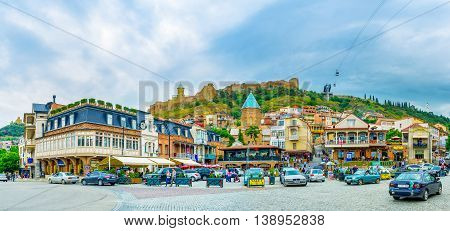 TBILISI GEORGIA - MAY 28 2016: The panorama of Vakhtang Gorgasali Square with the Narikala Fortress on the hill on May 28 in Tbilisi.