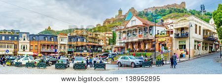 TBILISI GEORGIA - MAY 28 2016: The pleasant walk along Vakhtang Gorgasali Square with the view on the cozy cafes wine houses and family hotels on May 28 in Tbilisi.
