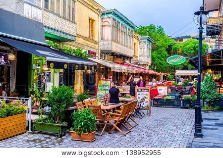 TBILISI GEORGIA - MAY 28 2016: The narrow streets boast the nice cafes and restaurants for each taste on May 28 in Tbilisi.