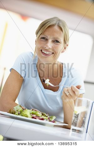 Woman Eating Lunch At A Cafe