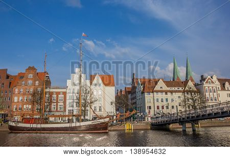 LUBECK, GERMANY - APRIL 20, 2014: Old ship and a bridge at the quay in Lubeck, Germany