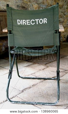 Green canvas directors chair viewed from the back