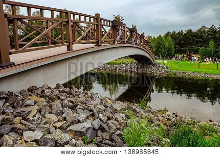 RUSSIA, BELGOROD - June 13 2016: New Belgorod zoo in the woods. Walking paths and a bridge across the pond.