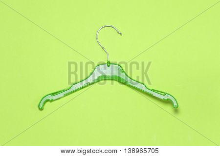 Hangers Isolated On The Light Green Background. Choosing Clothes Hangers.