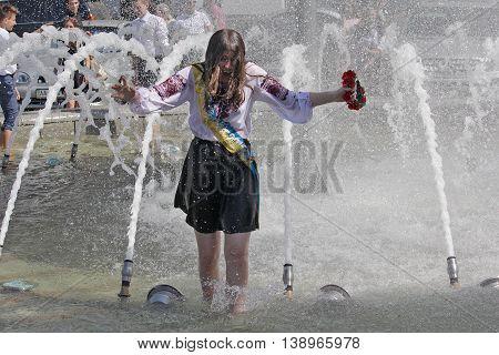 Kiev Ukraine - May 27 2016: Kiev graduates bathe in fountains. Last call 2016