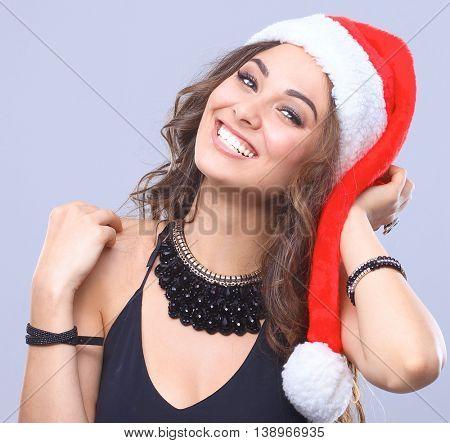 Attractive smiling woman in Santa Cap