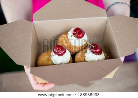 Cherry And Almond Bakewell Buns Held In Cardboard Box