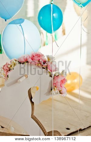 Beautiful Wedding Decorations With Balloons, Flowers And A Wooden Horse