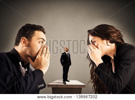 Businessman listens to a woman and a man