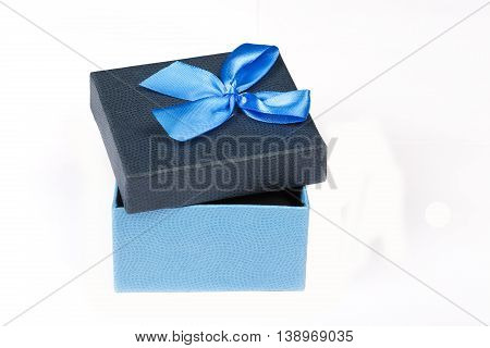 Blue Gift box with ribbon isolated on white background