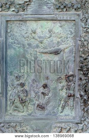 PISA, ITALY - JUNE 06, 2015: PISA, ITALY - JUNE 06, 2015: Adoration of the Shepherds, detail of the bronze door to the left of the Cathedral St. Mary of the Assumption in Pisa, Italy on June 06, 2015