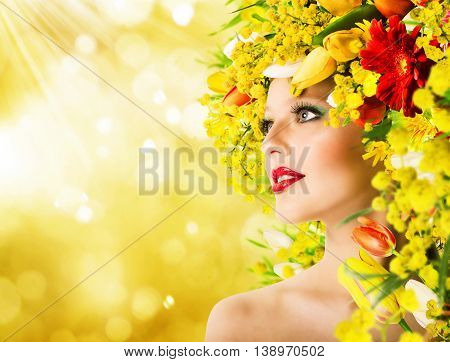 Model with hairstyle with flowers and makeup