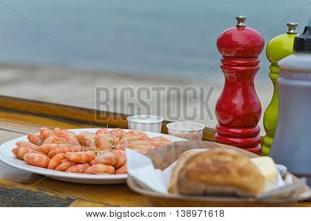 Ordered seafood platter served in mediterranean restaurant against the sea