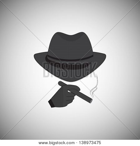 Mafia picture. Silhouette of a man in a hat with a cigarette in his hand