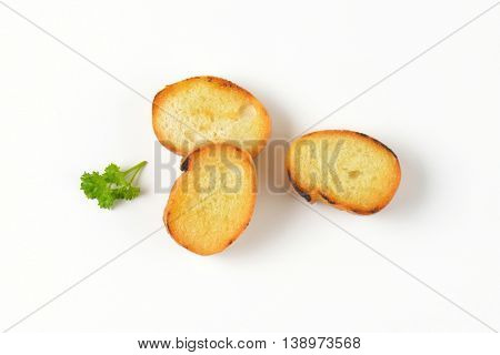 three pan fried French bread slices