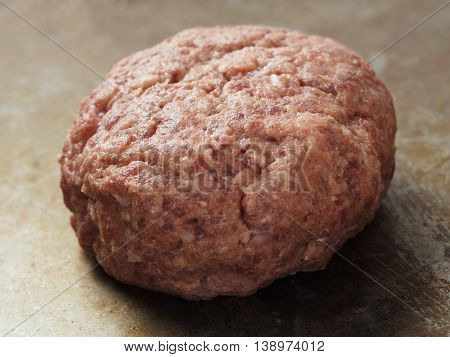 close up of rustic uncooked hamburger patty