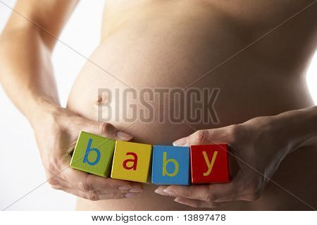 Pregnant Woman Holding Blocks Spelling