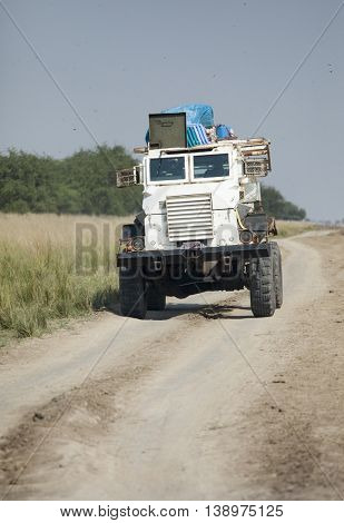 LILIIR, SOUTH SUDAN, DECEMBER 3, 2010: A United Nations mine sweeping vehicle travels a road in South Sudan