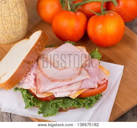 Delicious ham sandwich with lettuce tomato and cheese