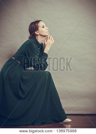 Sad woman retro style portrait long dark gown vintage photo