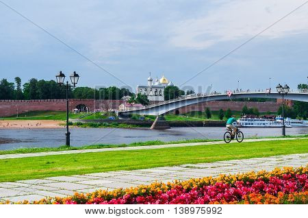 VELIKY NOVGOROD RUSSIA - JULY 15 2016. Novgorod Kremlin and embankment near the Volkhov river in summer cloudy day. Selective focus at the Kremlin
