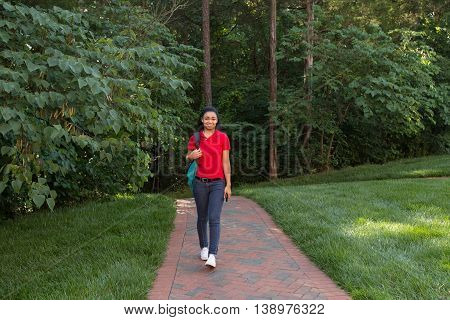 Young african american college student walking on campus